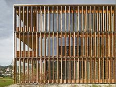 Image: Facade with sun protection from vertical wooden louvered shutters