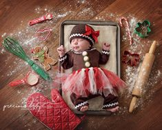 Adorable newborn Gingerbread man -- girl sleeping in a pan, sticking her tongue out. Christmas Cookie cutters heart rolling pin flower unique creative funny hilarious Precious Baby Photography Baby ImaginArt by Angela Forker New Haven Fort Wayne Indiana