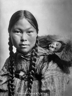 The beautiful and serene expression of a young Inuit mother & baby (papoose)
