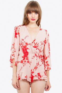 c5da0ab414 Floral printed romper with a ruffle detail on the hem- Bell sleeves- Wrap  front with a snap button closure- Stretch band at waist- Lined- Color   Orange ...