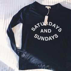 """Saturdays & Sundays"" Long Sleeve V-Neck Tee •Lightweight long sleeve tee that pays homage to the weekends.  •Size 0 = X-Small. Navy blue. V-neck. Semi-sheer.  •New with tag. NO TRADES/PAYPAL Sundry Tops Tees - Long Sleeve"