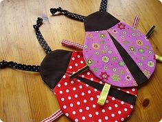 Lady Bug Taggies <--- awwwwwwwwwwwww so cute! My second one here - http://suddenlysandra.blogspot.ca/2012/10/post-thanksgiving-post-d.html (the first one wasn't very nice so I'm not posting it, lol).
