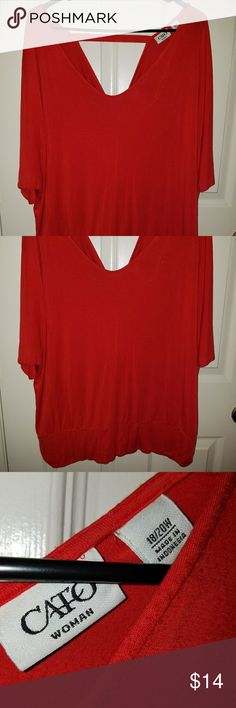 Pretty coral Cato blouse Super cute Coral colored top.. Band on bottom and cutout in back.. Looks great with jeans.. Soft.. Worn once...18/20 Cato Tops Blouses