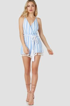 87dcc932f9c3 Playful spaghetti strap romper with overlap V-neckline. Stripe patterns  throughout with fun tassels
