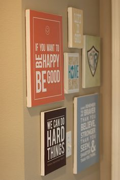 Free printables. Print them on scrapbook paper and then mod podge them to a board.