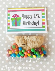 Fun idea for kids with summer birthdays! Put half a cookie in a bag with fun candy. FREE bag topper printable that comes in 3 color choices!