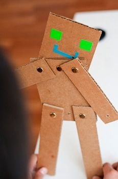 Simple and easy ~ cardboard shapes and brads. Great tool for refining fine motor skills.