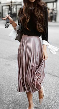 a blush pleated skirt that matches with a black shirt
