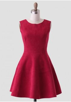 <p>Ideal for an upscale occasion, this vibrant red. faux micro suede dress is designed with a flattering fit-and-flare silhouette and a V-cut back with hidden zipper closure. Accessorize this luxe frock with a jeweled statement necklace and metallic heels for an elegant ensemble. Unlined, opaque.</p><p>95% Polyester, 5% Spandex<br /> Imported<br /> 32