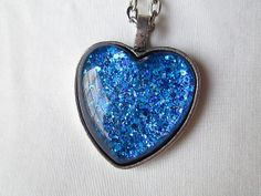 Sapphire Blue Heart Pendant Necklace by TheHowlingBoutique on Etsy, $16.00  Follow my shop's board: http://www.pinterest.com/howlingboutique