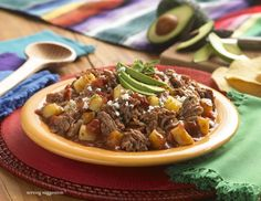 Pork Tinga, Create a slow cooker full of hearty, home-style Mexican comfort food that's perfect for feeding a crowd.