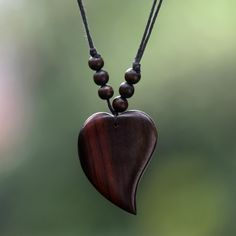 "Simple and pretty enough to wear every day, a masterfully carved heart of natural beauty centers the design of this necklace from Bali. Weight: 0.28 oz Measurements: - Cord length: 15"" min L - x 32.5"""