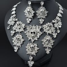 Rhinestone Skull Necklace & Earrings Set.  You'll certainly stand out in this rocking skull set.