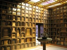 Interior of a columbarium in Oakland, California (Julia Morgan's Chapel of the Chimes). Some of the cinerary urns are book-shaped.