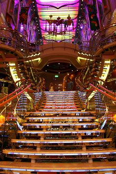 "Step on up to the Royal Promenade onboard Liberty of the Seas. This four-deck high ""Main Street"" is the heart of the ship."