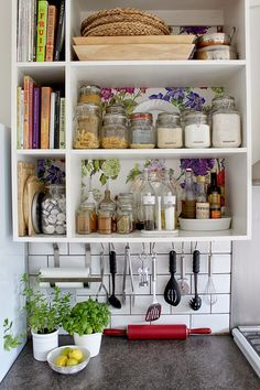 fun, floral paper behind kitchen shelving