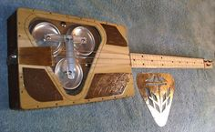 by Brian Romero and uses three soda can bottoms balanced as a tri-cone resonator guitar.