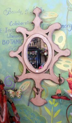 """Mirror, Mirror, on the Wall. Vintage  hand painted wooden  cut out wall mirror. Inscribed with the words mirror mirror on the wall above the mirror also three double hooks on lower area.  Dimensions 44""""x 28"""""""