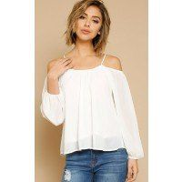 Woven top featuring a scooped neckline. Long sleeves with elastic cuffs and cold shoulder accents. Relaxed hemline with single stitching. Lined. Lightweight.100% PolyesterHand Wash ColdImportedModeled in size Small