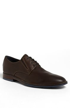 $124, Dark Brown Leather Derby Shoes: Hush Puppies Style Plain Toe Derby Dark Brown Leather 105 M. Sold by Nordstrom. Click for more info: https://lookastic.com/men/shop_items/81283/redirect