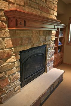 Inspiration for the wood mantle and new insert for our stone fireplace