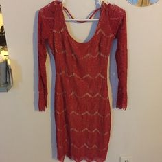 Bebe Red & Tan Lace Long sleeved Dress Scoop neck with deep scoop back. Very comfortable, soft fabric - red lace over a nude shell. Hits above the knee. Size Small. Wore once to a rehearsal dinner - mint condition!! bebe Dresses Mini