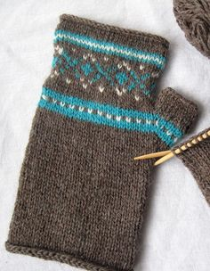 Free Knitting Pattern for Sporty Mitts - These fair isle fingerless mitts are a great stashbuster. Designed by Colleen Powley. Pictured project by tressalee