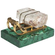 Russian gilt bronze sleigh carrying a piece of ice on malachite base.  19th century