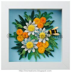 Quilling picture: Daisies, mums and a bumblebee.
