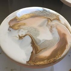 So dreamy this resin painting #resinart #resincoasters #peachandgold