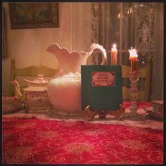 Tasha Tudor's Snow Before Christmas, Turkey Red Tablecloth, Bees wax candles, and Luster ware Tea pot and Tea cupsGrammy's house...... a quaint Victorian cottage