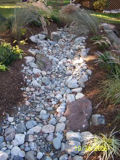 dry creek bed landscaping ideas   Dry creek bed with garden landscape
