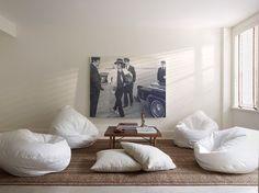 Rug + throw pillows + beanbags + coffee table = cosy (interiors - Sara Costello):