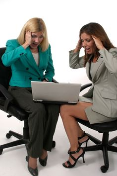 Two Business Women Working On Laptop 6