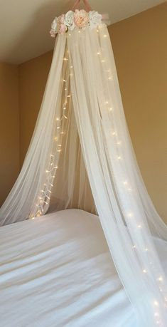 Use coupon code 10OFF at checkout for 10% off  Handcrafted blush pink and white rose floral canopy. Simple white ribbon trimmed canopy crown lined with pearls in the front. Artificial floral embellishments blush pink and white in color, cover both sides/front of canopy. Sparkle dusty pink ribbon is used for bows on side of canopy and dusty pink ribbon hangs up bed canopy. A loop is left at the top for hanging purposes. Jeweled chandelier is created on the inside of crown using light pink/hot…