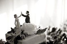 Elegant in black and white, the fun factor of our High Fiving Bride and Groom still shines through! Design your own custom wedding cake topper here: http://www.weddingstar.com/product/high-five-figurine