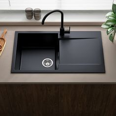 Our modern black granite finish will look at home in any contemporary kitchen! It is manufactured from extremely durable granite composite which is scratch, stain and impact resistant - the Amsterdam can cope with almost anything. Small Kitchen Sink, Granite Kitchen Sinks, Modern Kitchen Sinks, Kitchen Taps, Composite Sinks, Shower Fittings, Bowl Designs, Black Granite, Aesthetic Design