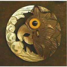 Carved mother-of-pearl button with glass, bird design c1900.