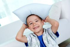 Toddler boy with A Little Pillow Company pillow on his head