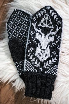 Free Knitting Pattern for Patronus Mittens - Inspired by the magical world of Harry Potter, as well as some traditional Norwegian patterns, these mittens feature a stranded design of Harry's Patronus Stag. Designed by Amanda Sund. Aran weight yarn.