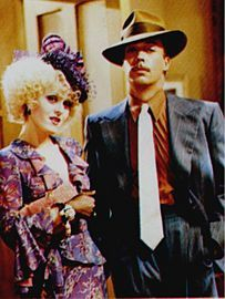Lily St. Regis (Bernadette Peters) and Rooster Hannigan (Tim Curry) in Annie 1982