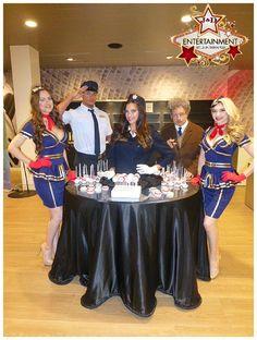 Attendants airline hostess pilot strolling table houston models