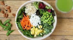 freshii metaboost salad: field greens and spinach, kale, mangos, carrots, edamame, almonds, goat cheese, balsamic vinaigrette