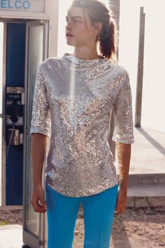 Bergdorf Goodman Resort. Imagine doing the twist in this gleaming top and bright pants!