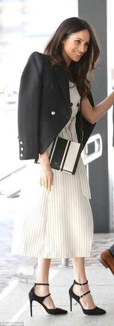 The bride-to-be opted for a monochrome colour scheme, in a pinstripe dress accessorised with a black and white handbag Meghan Markle Style, Meghan Markle Outfits, White Handbag, British Monarchy, Royal Fashion, Style Fashion, Princess Meghan, Prince Harry And Meghan, Princess Diana