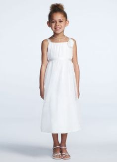 A look and feel that your flower girl will love to wear over and over again!  Tank A-line bodice features all over dot chiffon detailing with 3D floral embellishment.  Tea length skirt is light and airy.  Back zip. Imported polyester. Dry clean only.