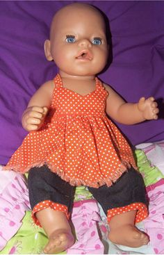 Noela has been very busy sewing lots of doll clothes for her granddaughter's Baby Born and Cabbage Patch dolls using my patterns and video instructions. I absolutely love the color cotrast of orange and navy in this Handkerchief top and Capri pant combination.