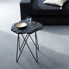 To create our Forma Side Table, slabs of slate are cut by hand, resulting in beautifully organic forms that are subtly unique to each piece. It's part of west elm Collection—a line that blends the best of west elm with luxe materials, refined finishes and impeccable details.