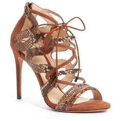 elenara genuine python skin cage sandal by Alexandre Birman. Straps of genuine python skin curve and arch sensuously throughout the cage of a breathtaking sandal set atop a tower...
