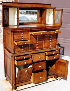 The bun feet of the cabinet have been replaced to match the original feet, and are quarter sawn oak. Dimensions of this great early dental cabinet are; 60